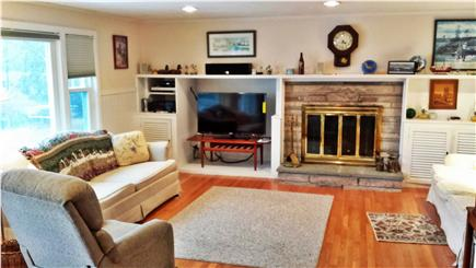 Harwich Cape Cod vacation rental - First floor family room with 46 inch  tv with pond views