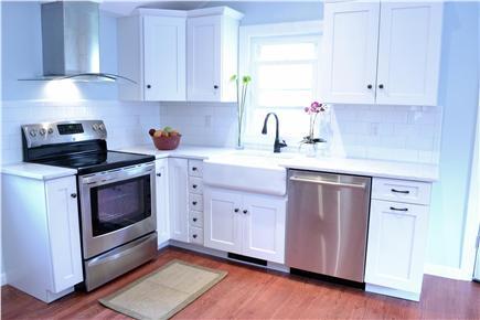 Chatham Cape Cod vacation rental - New Kitchen w/ Farmhouse Sink, Dishwasher & Minuet Stone Counter