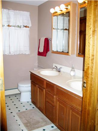 Harwich Cape Cod vacation rental - Hall bath with shower/tub combination and jack-n-jill sinks