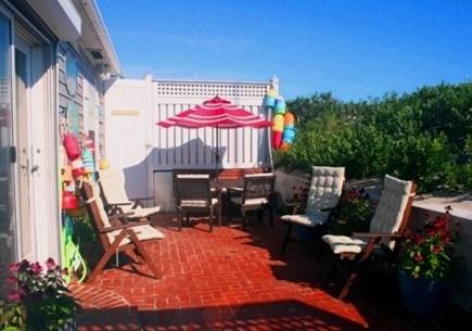 East Sandwich Cape Cod vacation rental - Enjoy dining on the breezy sea salt air oceanside patio.