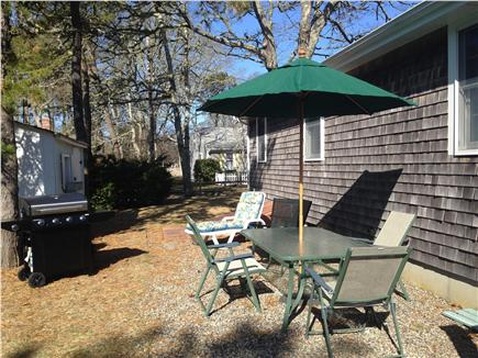 Dennis Port Cape Cod vacation rental - Large private back yard with patio set and gas or charcoal grill