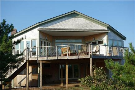 Wellfleet Cape Cod vacation rental - This side of the house, with a capacious deck, faces the water.