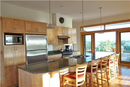 Wellfleet Cape Cod vacation rental - The kitchen has a sweeping granite island.