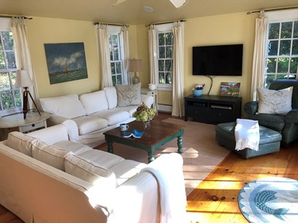 East Orleans Cape Cod vacation rental - Family room with doors to deck, TV, adjacent to galley kitchen