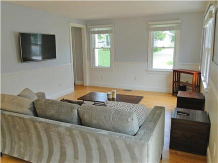Mashpee, Popponesset Cape Cod vacation rental - Family room area opens up to dining and kitchen