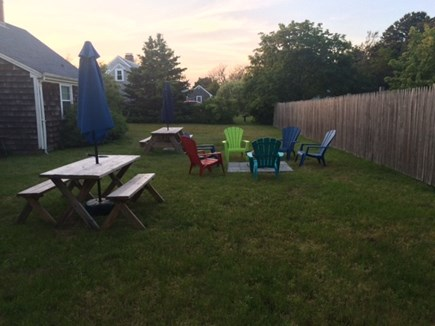 Dennisport Cape Cod vacation rental - Large partially fenced yard.  Enjoy fire pit and cookouts.