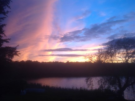 Hyannisport Cape Cod vacation rental - One of the many sunsets to enjoy from Holidayfarm over the pond.
