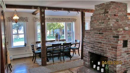 Hyannisport Cape Cod vacation rental - Farmhouse kitchen table with view of Simmons Pond