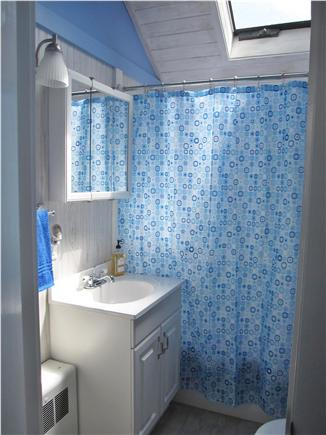 North Truro - Beach Point Cape Cod vacation rental - Bath with tub-shower combination and skylight
