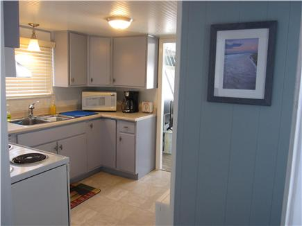 North Truro - Beach Point Cape Cod vacation rental - View of the kitchen from the front hallway