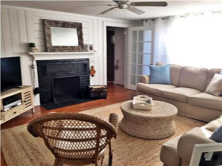Centerville, craigville village Centerville vacation rental - Other view of living room,ceiling fan & fireplace