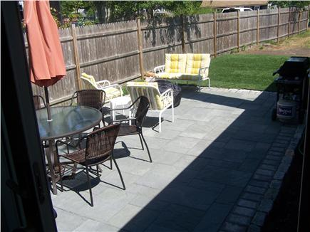 Dennisport Cape Cod vacation rental - New patio with dining table, patio furniture and metal fire pit