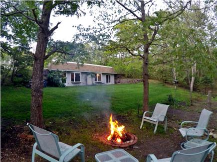 Brewster Cape Cod vacation rental - The fire pit with plenty of wood