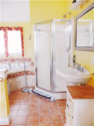 Hyannis Park/West Yarmouth Cape Cod vacation rental - The upstairs Master bath with marble tile, jacuzzi & shower