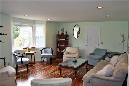 E. Harwich Cape Cod vacation rental - First living room is open, spacious, cooling.