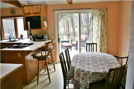 E. Harwich Cape Cod vacation rental - Dining area in the open kitchen with a slider to the back deck.