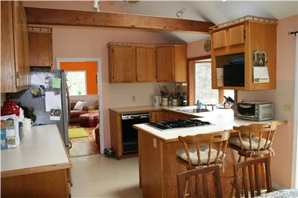 E. Harwich Cape Cod vacation rental - Kitchen with baywindow, skylight and ceiling fan.