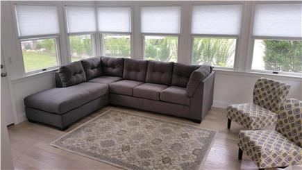 Harwichport Cape Cod vacation rental - Main house sunroom with pullout queen-sized sofa bed