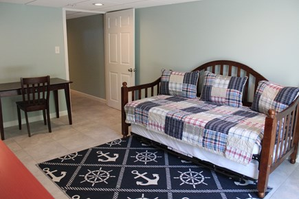 Dennisport Cape Cod vacation rental - Downstairs room with a daybed with trundle