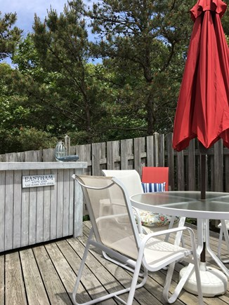 Eastham Cape Cod vacation rental - Back Deck with dining table and chairs