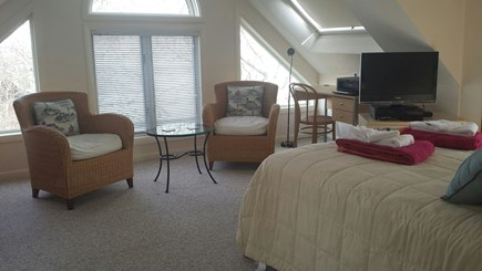 Provincetown Cape Cod vacation rental - King size bed and sitting area on top floor