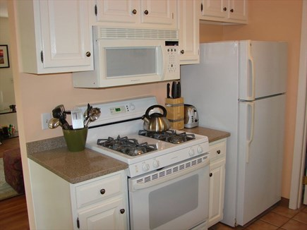 Provincetown Cape Cod vacation rental - Other side of kitchen with gas stove, microwave and refrigerator