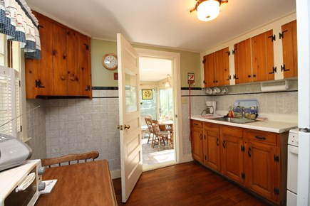 Dennis Port Cape Cod vacation rental - This comfortable kitchen leads right into the enclosed porch