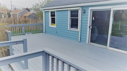 Barnstable Harbor Cape Cod vacation rental - 28x12 foot deck. Can see water a bit, 300 feet to the Bay