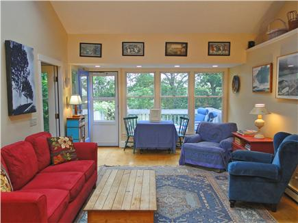 Brewster Cape Cod vacation rental - Living area with dining table and door to deck with views of Bay