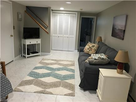 Eastham Cape Cod vacation rental - Full basement with chair, sofa and TV.  A very relaxing place.