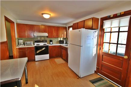 Eastham Cape Cod vacation rental - Kitchen fully stocked with dishes, utensils and more plus table.