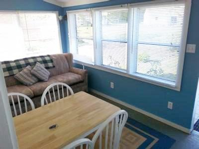 Eastham Cape Cod vacation rental - Daybed (no couch) and eating area in Windowed Porch