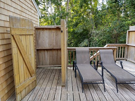Wellfleet Cape Cod vacation rental - Deck view towards woods in back with large outdoor shower