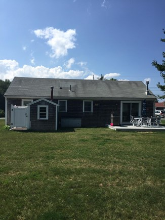 Barnstable Cape Cod vacation rental - Backyard, patio with grill, table/chairs and outdoor shower