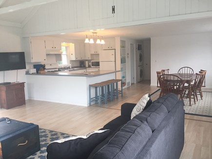 Barnstable Cape Cod vacation rental - Open Kitchen and Living area with a mounted 48 inch TV