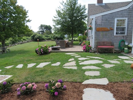 East Dennis Cape Cod vacation rental - Rear of house, patio, patio table, picnic table, yard games