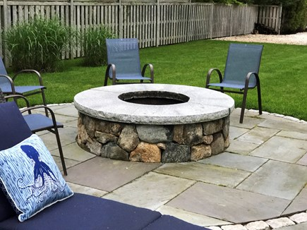 Seconsett Island, Mashpee Cape Cod vacation rental - Fire pit surrounded by chairs
