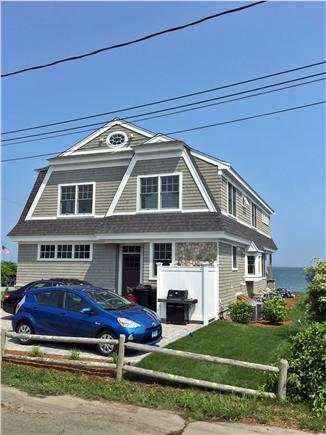 Mashpee Cape Cod vacation rental - Back of house with large paver driveway