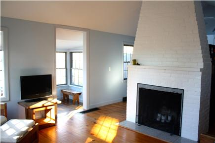 Harwich Cape Cod vacation rental - Cathedral ceiling and central fireplace in open living area