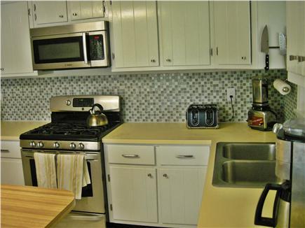 Chatham Cape Cod vacation rental - Kitchen - Modern gas stove, microwave, dishwasher, fridge freezer