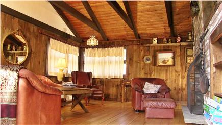 North Eastham Cape Cod vacation rental - The Living Room has a cathedral ceiling and wide pine floors.