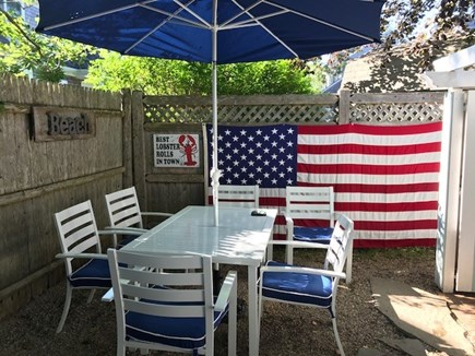 Falmouth Heights Cape Cod vacation rental - Private area in back – grill and dining