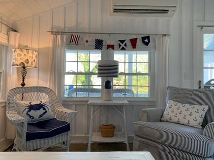 Falmouth Heights Cape Cod vacation rental - Sunny comfy LR with flatscreen TV (on arm) and sleep sofa