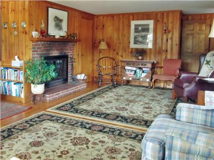 S. Wellfleet Cape Cod vacation rental - Fireplace in Wood Paneled Living Room
