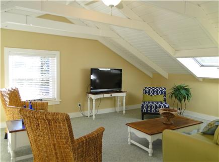 West Harwich Cape Cod vacation rental - Upstairs family room with skylights and TV