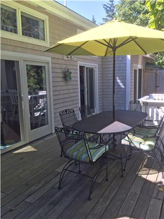 West Harwich Cape Cod vacation rental - Back yard deck with dining area, facing large yard