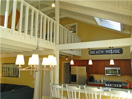 West Harwich Cape Cod vacation rental - View of high ceilings, kitchen breakfast bar, plus upstairs loft