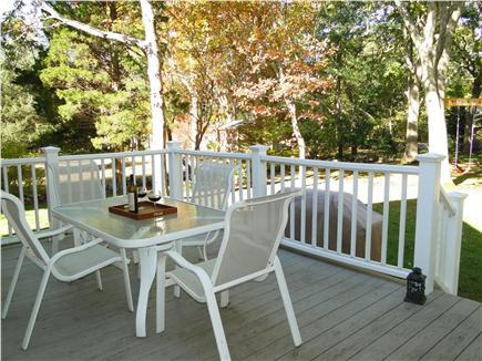 Pocasset Pocasset vacation rental - Deck area with grill, overlooks yard, swing set