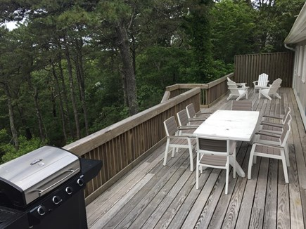 Brewster Cape Cod vacation rental - Large deck with outdoor dinning, grill and Adirondack chairs