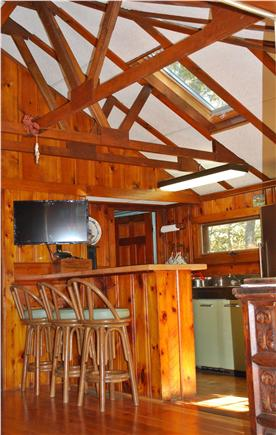 Dennis Cape Cod vacation rental - Breakfast Bar, w/ 32 inch TV visible in both Kitchen & Living Rm